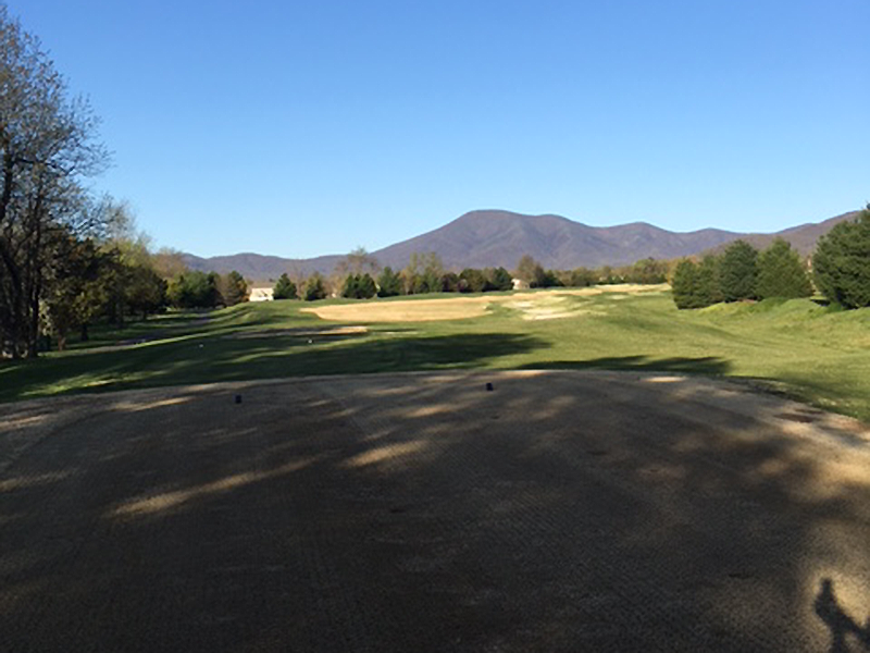 golf course with mountain view in the background