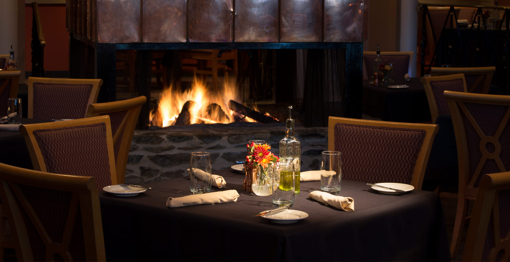 cozy winter dining by the fireplace at Wintergreen Resort